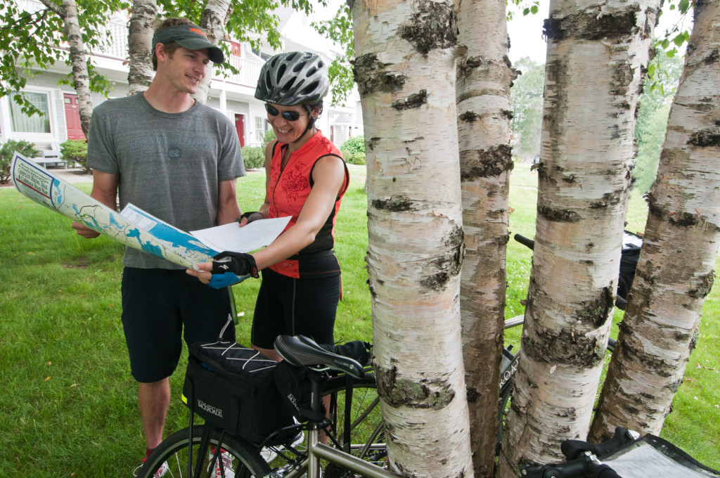 Cyclists looking at route map on our Maine Bicycle Tour
