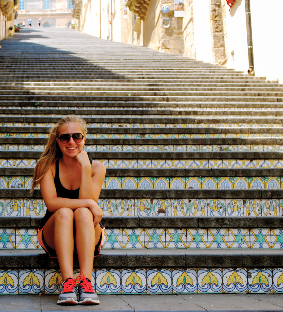 Girl sitting on steps in Sicily, Italy